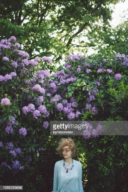 Woman Against Purple Flowering Plants