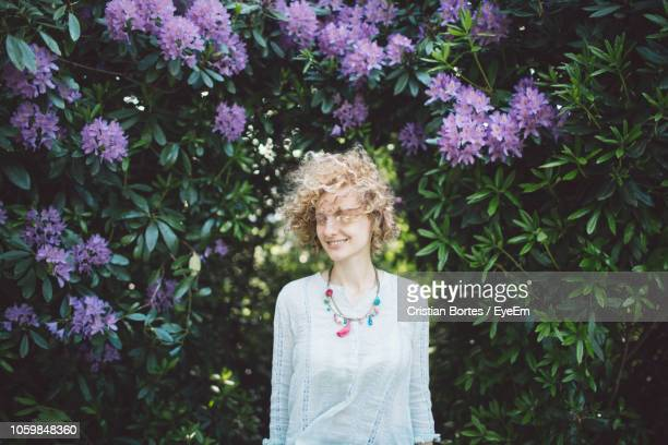 Woman Against Purple Flowering Plants