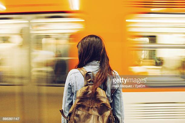 woman against speeding blurred train - waiting stock pictures, royalty-free photos & images