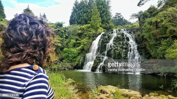 woman against waterfall at forest - cambridge stock pictures, royalty-free photos & images