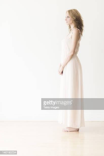 woman against white background, studio shot - women in slips stock photos and pictures