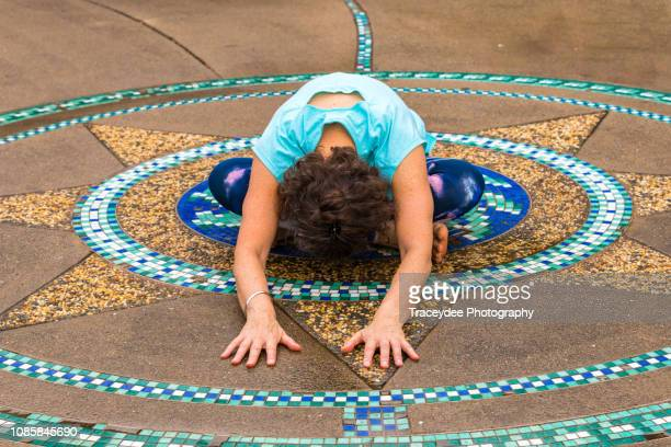 Woman aged 50 years and older relaxing with Yoga.