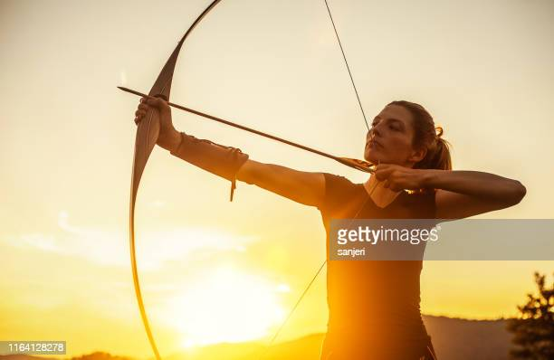 woman aiming in archery - archery stock pictures, royalty-free photos & images