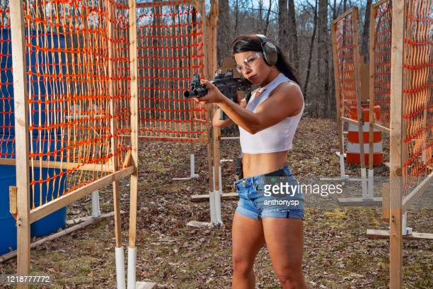 woman aiming pistol - ar 15 stock pictures, royalty-free photos & images