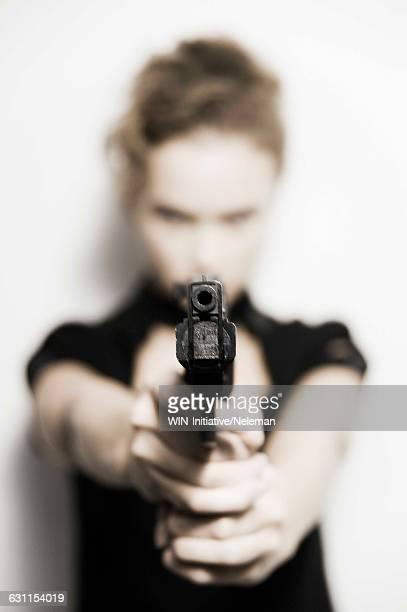 Woman aiming with a handgun