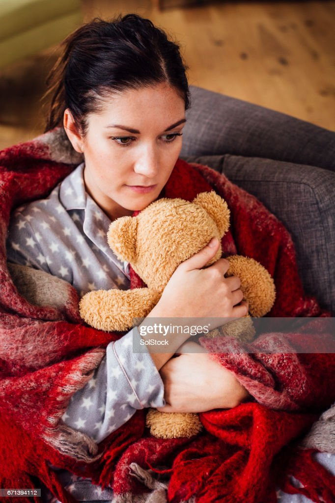 Woman Alone Holding a Teddy Close : Stock Photo