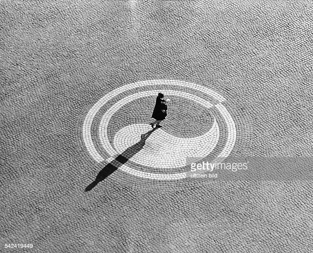 Woman alone in a circle with YinYang symbol