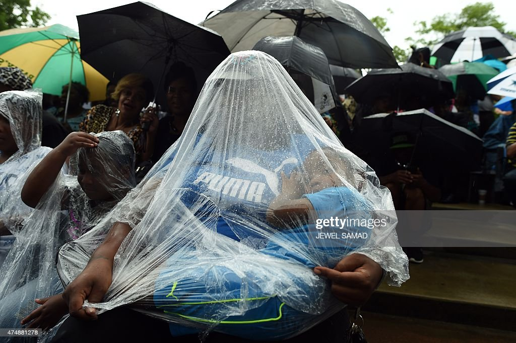 A woman along with her children attend a concert to pay tribute to blues musician B.B. King on May 27, 2015 in Memphis, Tennessee. Thousands of fans gathered in Memphis to say farewell to the blues guitar legend who died on May 14 at the age of 89 in Las Vegas where he lived while he kept up a grueling schedule of tours that ended only last year.