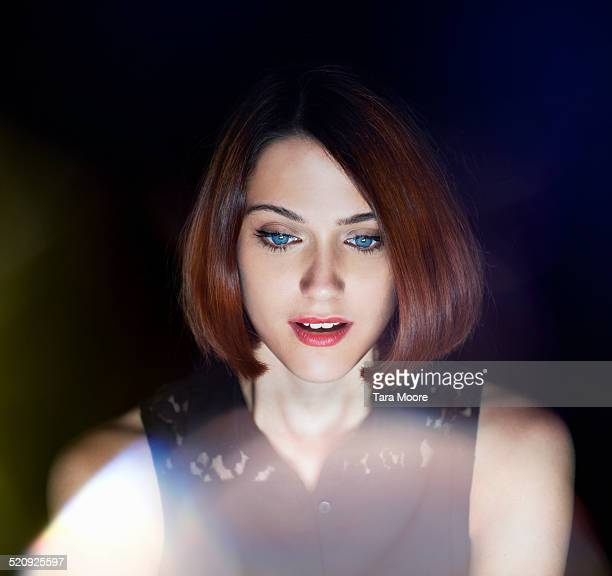 woman amazed by digital glow