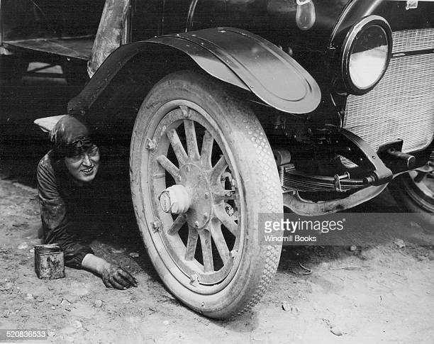 Woman ambulance driver repairing car Etaples