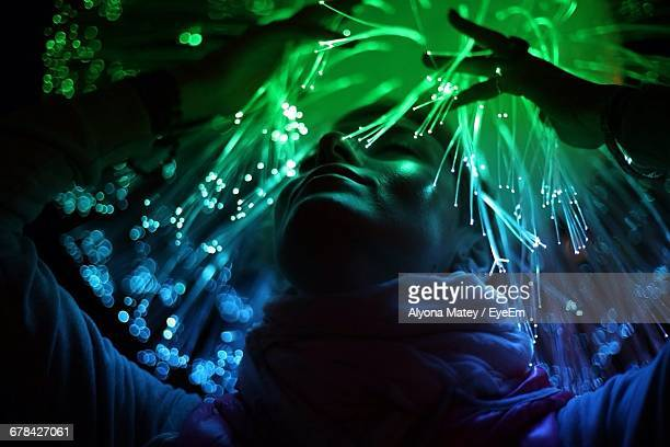 Woman Amidst Optical Fibre