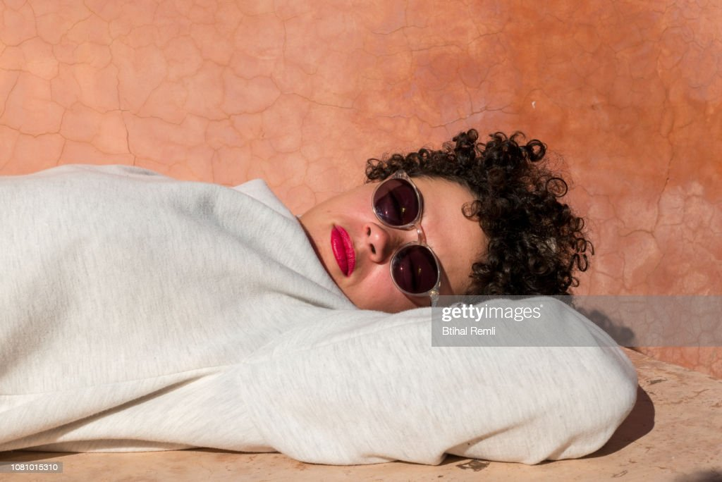 young woman laying in the sun : Stock Photo