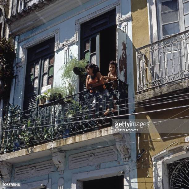 A woman and a boy standing on a balcony at Salvador da Bahia Brazil early 1990s