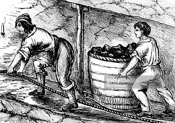Woman and a boy working in a coal mine Bolton Lancashire 1848 A woman and boy underground in a coal mine moving a basket containing 34 cwt of coal...