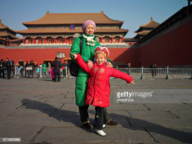 A Woman and a Girl in Pose for Pictures Inside the Forbidden City