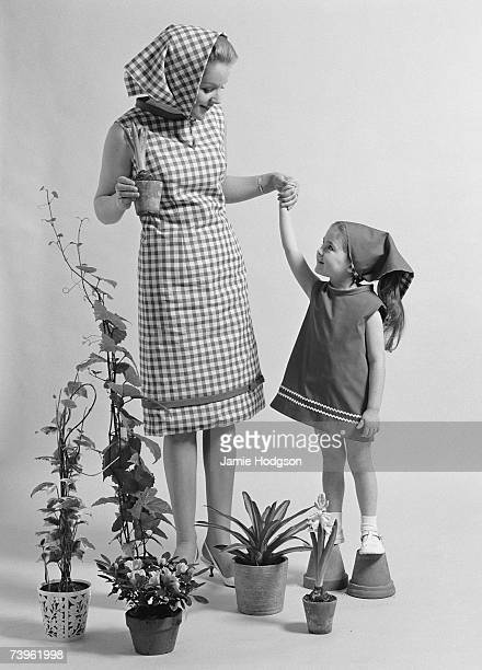 A woman and a little girl surrounded by potted plants 4th January 1965 A photoshoot for Mother magazine