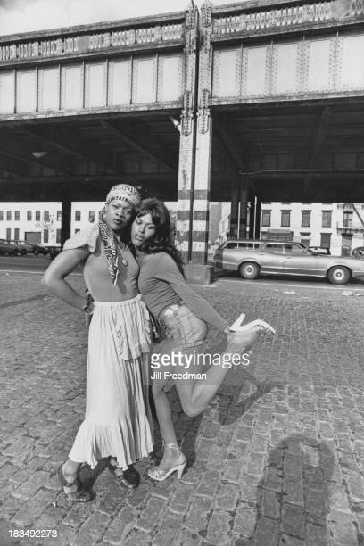 A woman and a man in drag pose for the camera by the West Side Highway Greenwich Village New York City circa 1979