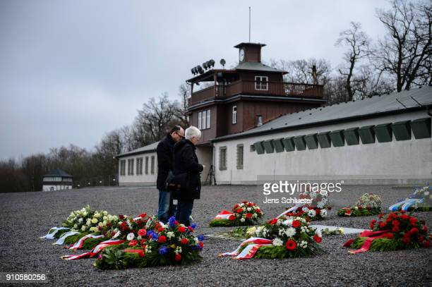 A woman and a man stand at the memorial plaque at the Buchenwald concentration camp memorial to commemorate victims of the Holocaust on January 26...
