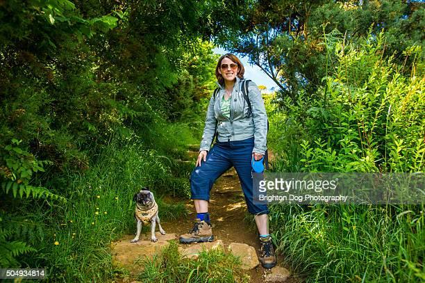 A woman and a Pug on a walk
