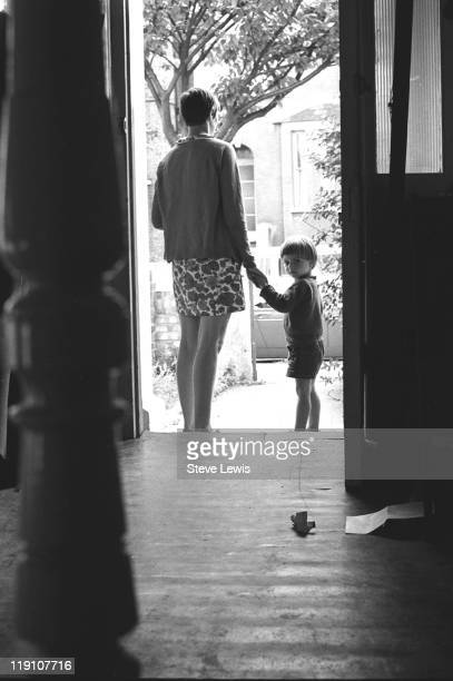 A woman and a small boy in a doorway east London circa 1970