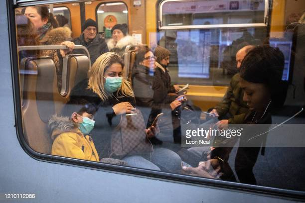 A woman and a small child wear protective masks as they travel on the underground train system on March 03 2020 in Brussels Belgium The European...