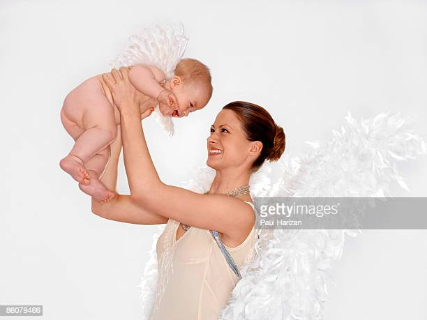 Woman and baby dressed as Angels