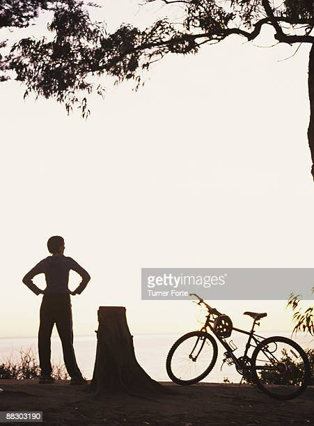 Woman and bicycle in silhouette