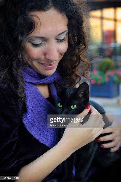 Woman and black cat