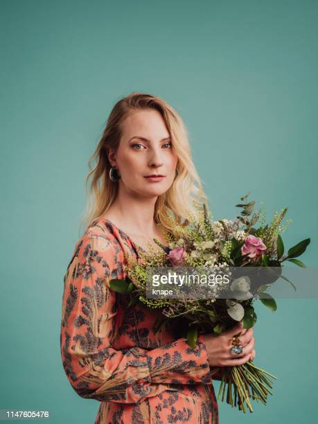woman and bouquet of flowers - multi coloured dress stock pictures, royalty-free photos & images