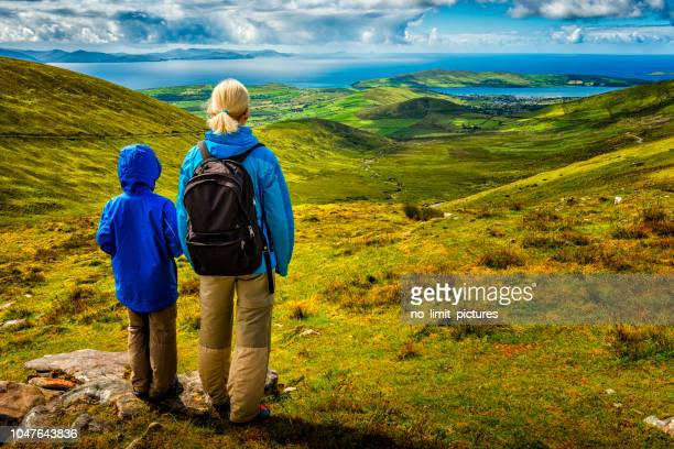 woman and boy hiking in ireland - republic of ireland stock pictures, royalty-free photos & images