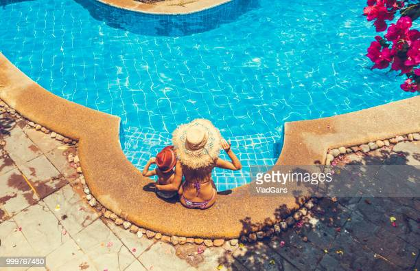 Woman and boy in the swimming pool