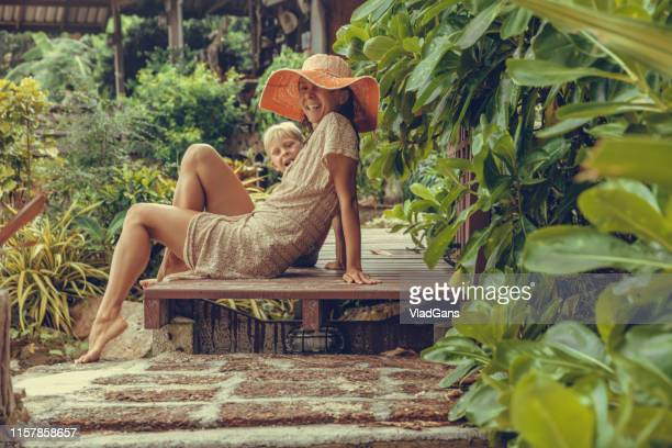 woman and boy in the tropics - vlad models stock photos and pictures