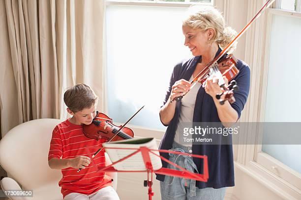 Woman and boy playing violin