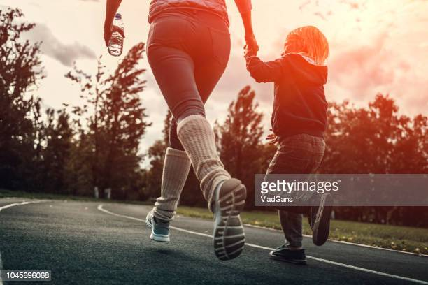 woman and boy running at the stadium