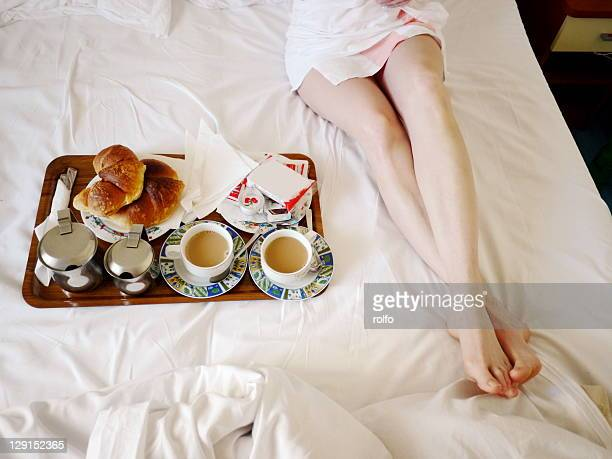 Woman and breakfast on bed