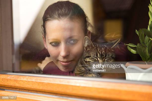 Woman and cat at the window