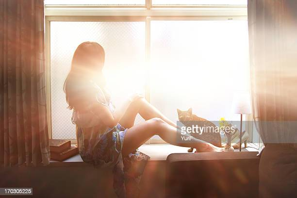 Woman and cat by the window.