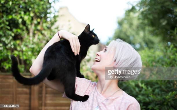 Woman and cat in garden