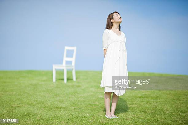 Woman and chair in field