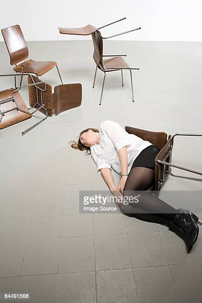Woman and chairs on floor