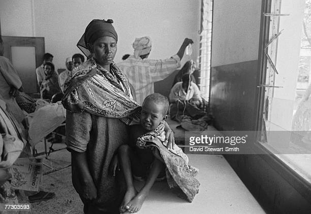 Woman and child at a Save The Children Fund feeding centre in Mogadishu during the Somalian civil war, January 1992.