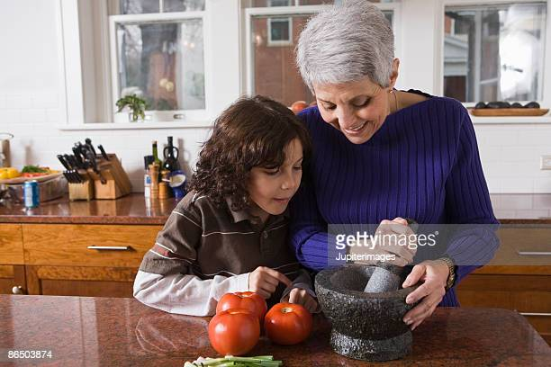 Woman and child cooking in kitchen
