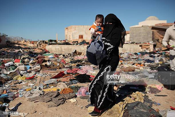 A woman and child enter Tunisia from Libya on March 02 2011 in Ras Jdir Tunisia As fighting continues in and around the Libyan capital of Tripoli...