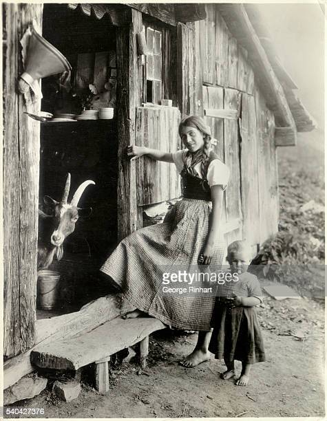 Woman and Child Entering Dairy Hut