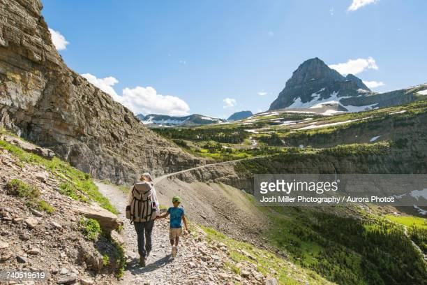 Woman and child hiking in mountainous region