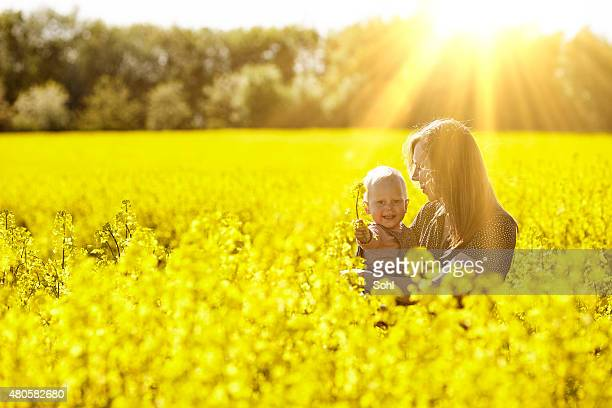 Woman and child in Yellow feild