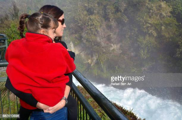woman and child looks at rushing stream of huka falls new zealand - rafael ben ari stock pictures, royalty-free photos & images