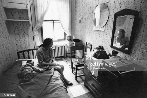 A woman and child rest in their room at a hotel on Broadway for people living on welfare New York City 1971