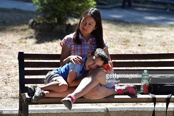 A woman and child sit on a bench after an earthquake on August 25 2016 in Amatrice Italy The death toll in the 62 magnitude earthquake that struck...