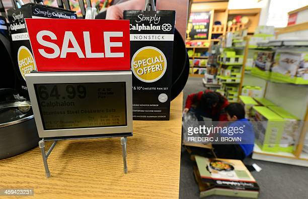 A woman and child take a closer look at cookware on sale at a Kohl's department store which opened at 5am a day after Christmas on December 26 2013...